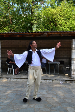 man with traditional costume dancing_300